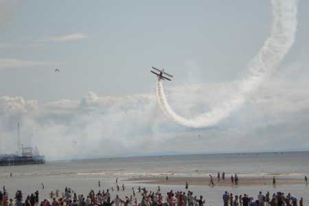 wing walking over Blackpool beach photo